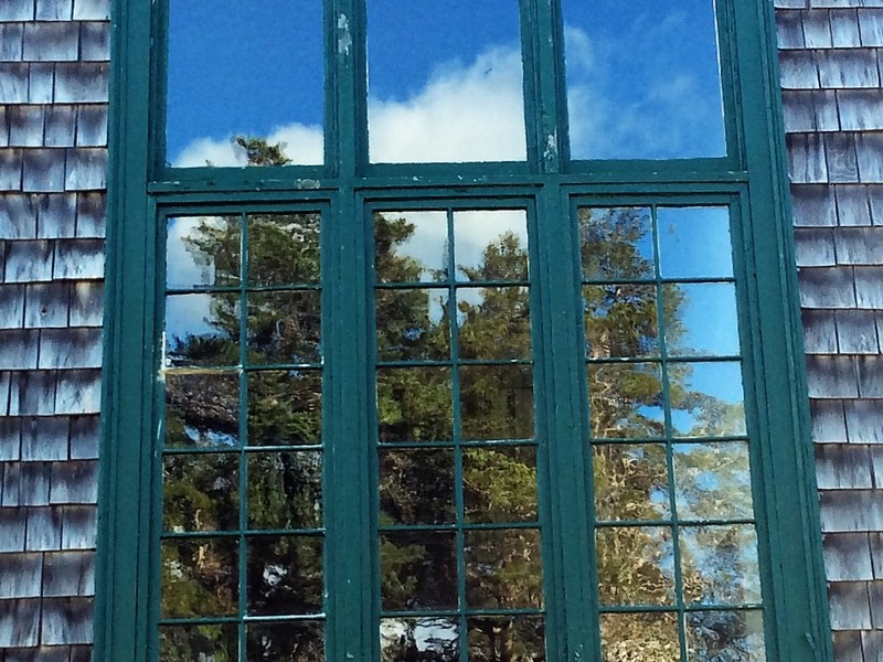 Reflections in old glass by a staircase window -